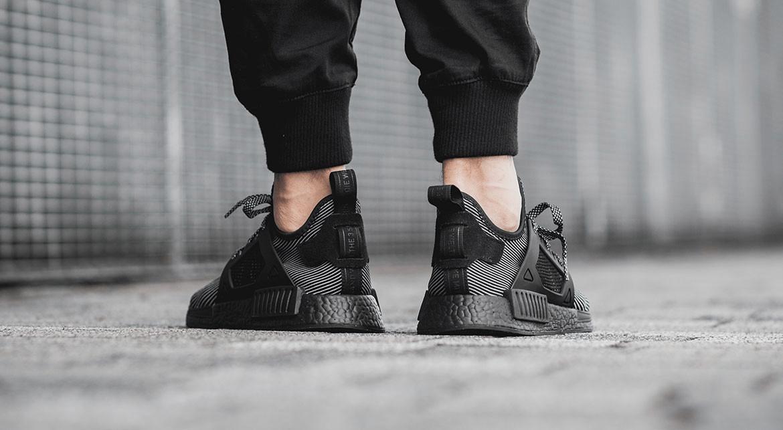 00aa21fb9 adidas NMD XR1 Black On foot 02 - FastSole.co.uk