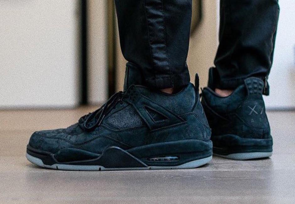 KAWS x Air Jordan 4 Black 01