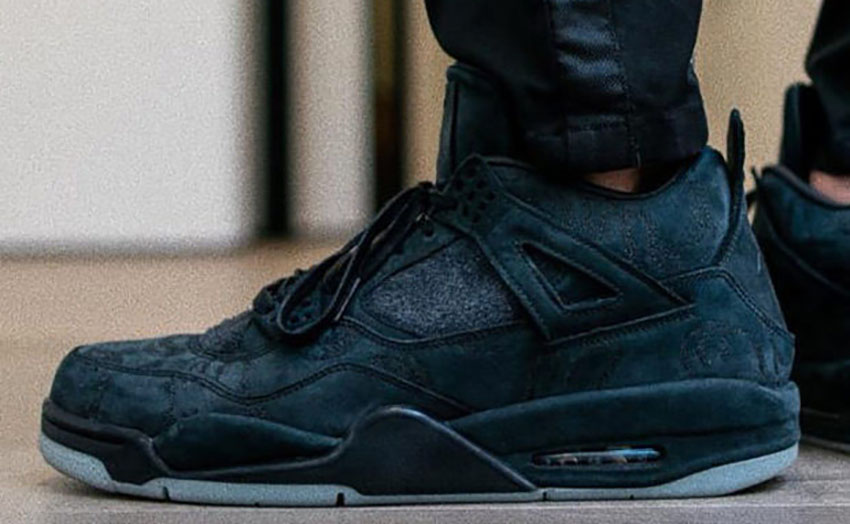 save off 5df94 312d6 KAWS x Jordan 4 Black is ready for Cyber Monday 2017 with its gorgeous  suede construct and the classic swag of Jumpman 4. Its triple black attire  is just ...