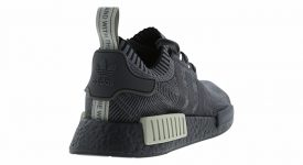 the latest 766d9 8e6a6 adidas NMD R1 Black Grey Footlocker Exclusive