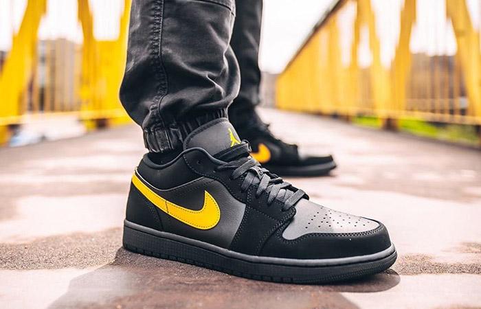 Footasylum Exclusive Jordan 1 Low Black Yellow on foot 01