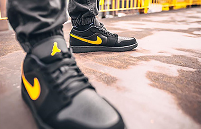 Footasylum Exclusive Jordan 1 Low Black Yellow on foot 02