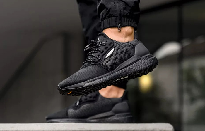 Pharrell adidas Solar Hu Glide Core Black EG7788 on foot 01