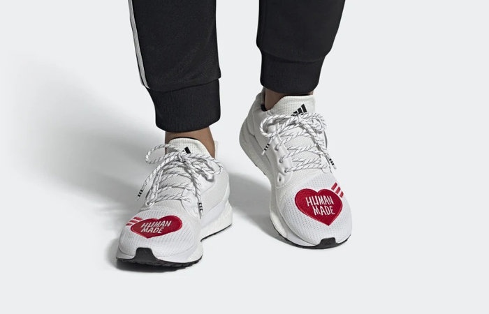 Human Made adidas Solar Hu Red White EG1837 on foot 01