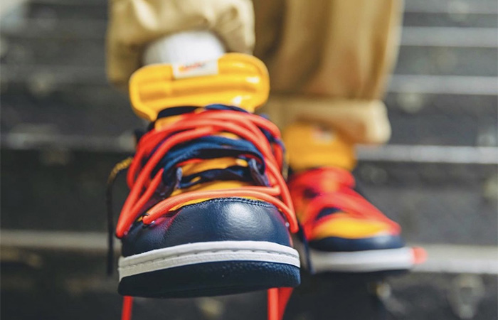 Off-White Nike Dunk Low Yellow Toe CT0856-700 on foot 02