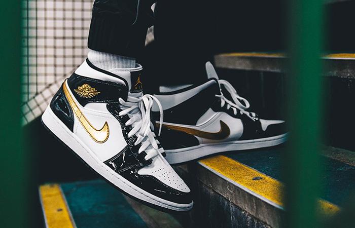 Nike Jordan 1 Mid Patent Black White Gold 852542-007 on foot 01