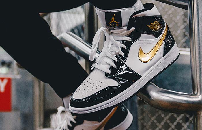 Nike Jordan 1 Mid Patent Black White Gold 852542-007 on foot 02