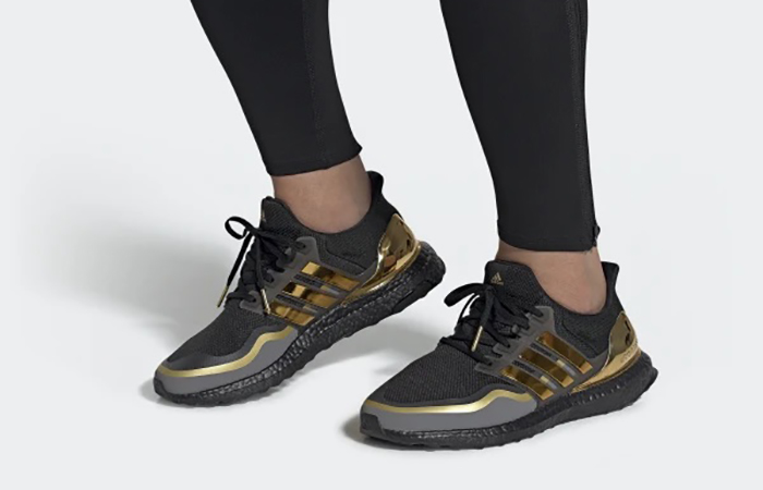adidas Ultra Boost 2019 Black Gold EG8102 on foot 01