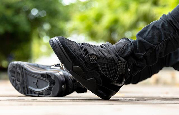 Air Jordan 4 Black Cat CU1110-010 on foot 01