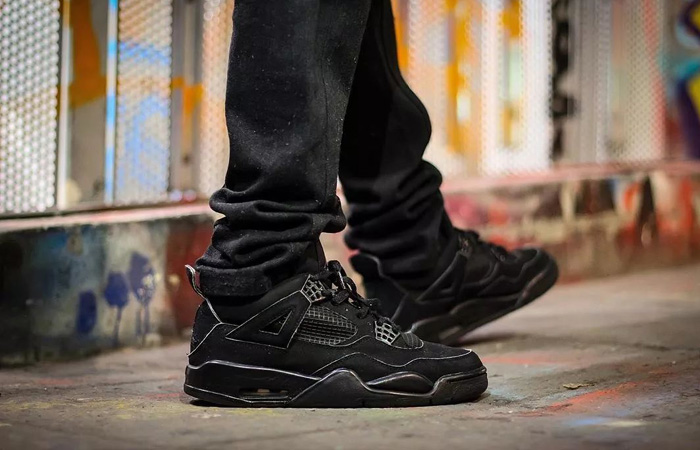 Air Jordan 4 Black Cat CU1110-010 on foot 02