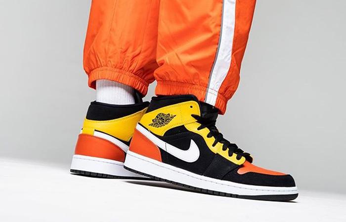 Jordan 1 Mid Amarillo Orange 852542-087 on foot 01