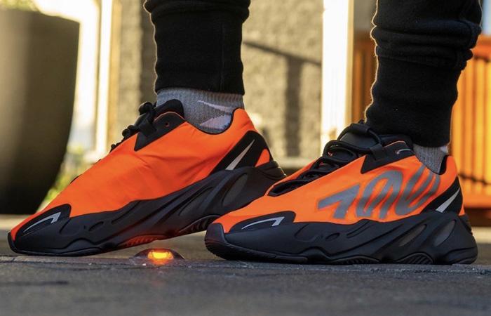 Yeezy Boost 700 MNVN Orange Black FV3258 on foot 01