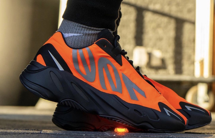 Yeezy Boost 700 MNVN Orange Black FV3258 on foot 02