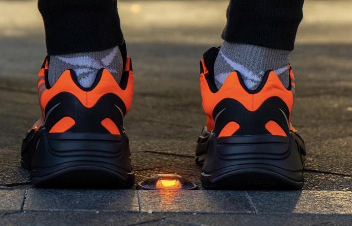 Yeezy Boost 700 MNVN Orange Black FV3258 on foot 03