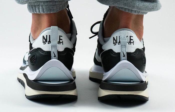 Sacai Nike Vaporwaffle Black White CV1363-001 on foot 03