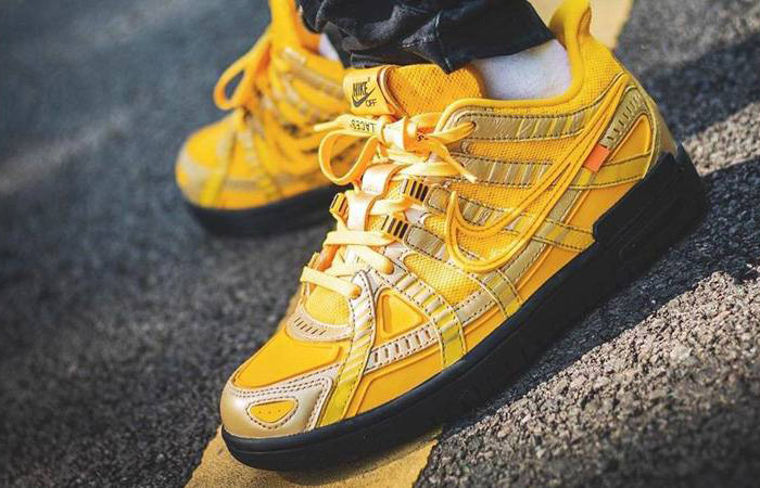 Off-White Nike Rubber Dunk University Gold CU6015-700 on foot 01