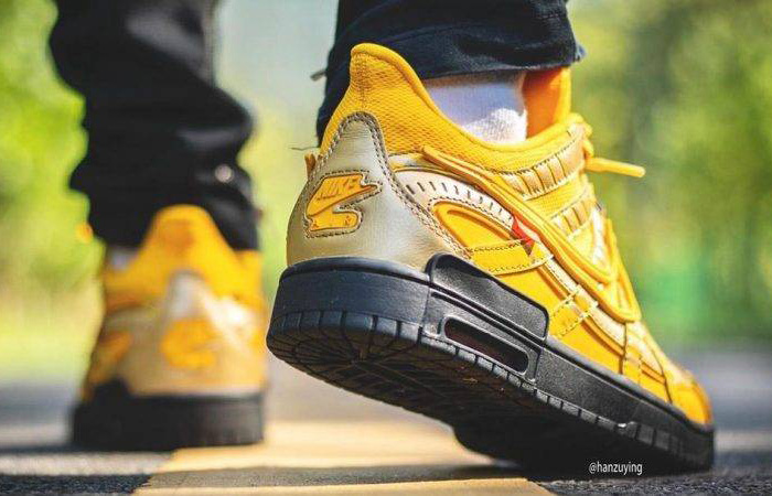 Off-White Nike Rubber Dunk University Gold CU6015-700 on foot 03