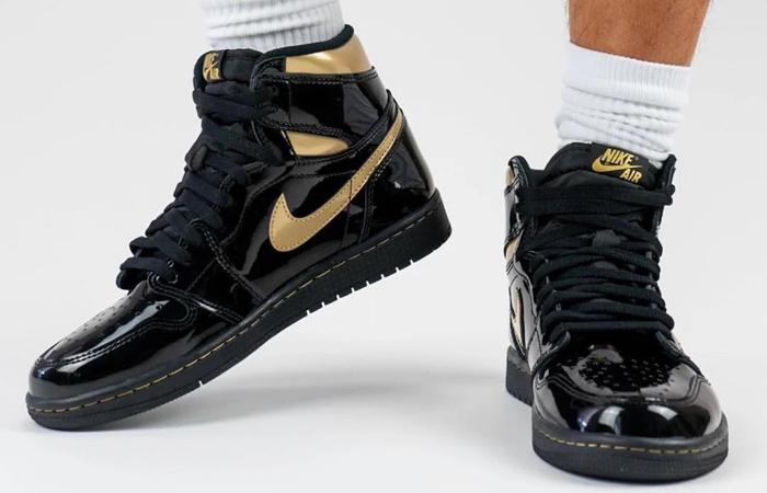 Air Jordan 1 High Patent Black Metallic Gold 555088-032 on foot 02