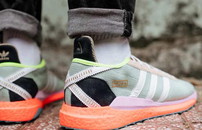 Pharrell adidas Tokio Solar Hu Navy Orange S42576 on foot 03