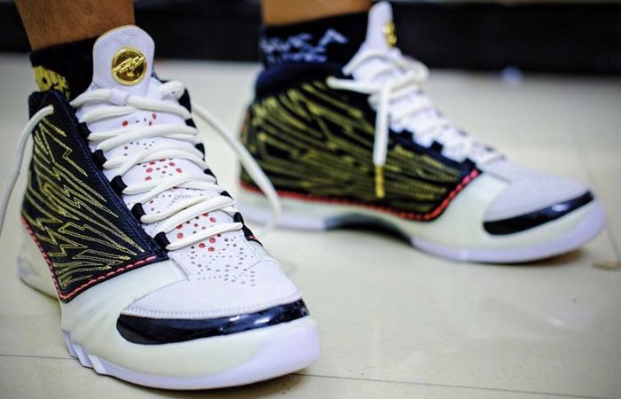 Titan Nike Air Jordan 23 Black Metallic Gold CZ6222-001 on foot 01