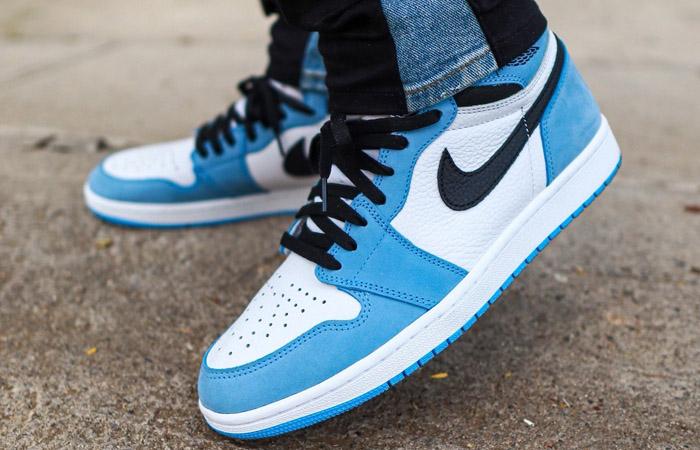 Air Jordan 1 High Black University Blue 555088-134 on foot 01