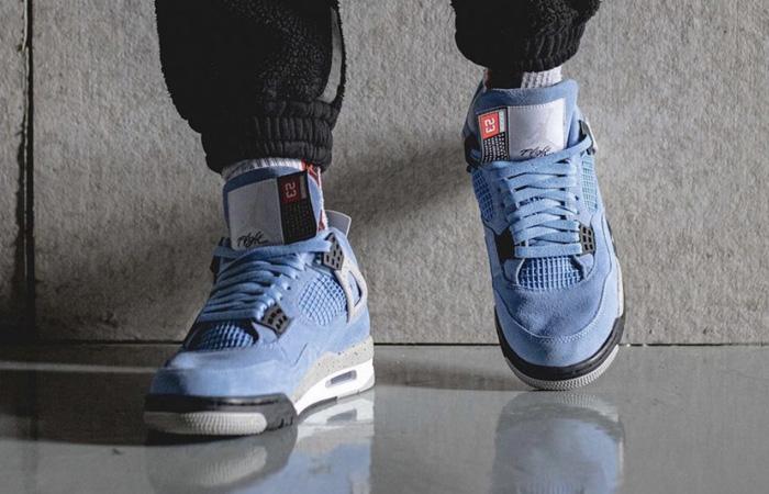 Air Jordan 4 University Blue Black CT8527-400 on foot 02