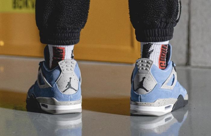 Air Jordan 4 University Blue Black CT8527-400 on foot 03